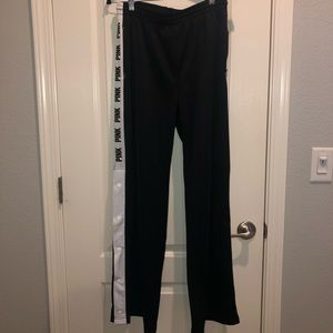 Track pants with snap detailing